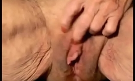 Most assuredly superannuated granny with huge clit