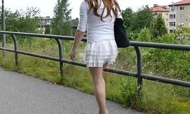Crossdresser walking on bridge