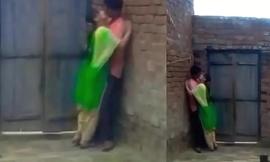 School students kissing in background in school