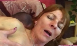 Busty brunette granny Ivet takes cock on couch