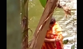 Sexy Bengali boudi soma bathing openly and showing his assets