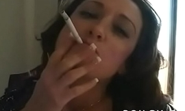 Mature floozy blows a guy while smokin'_ a cigarette